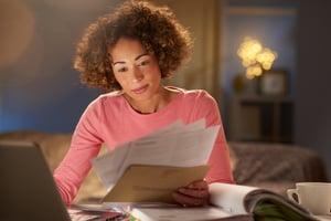 Woman reviewing bills -635908794